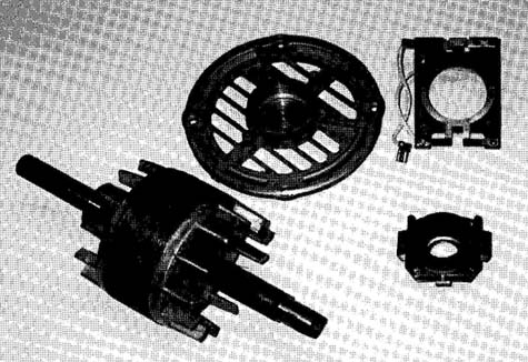 A centrifugal switch removed from its end plate. The flyweight mechanism has also been removed from the motor shaft.